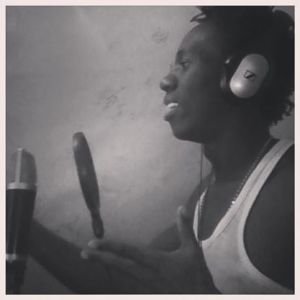 Tripple S in studio recording music.