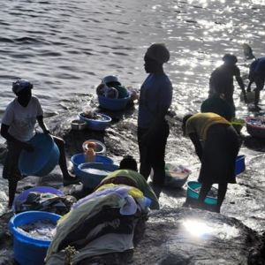 A group of women washing clothes in Lake Victoria. #TembeaKenya.
