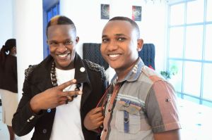 Sweet Boy on the left poses for a photo with Dr Eddie during the making of 'Nitangoja' video at Pearl Hotel in Eldoret.