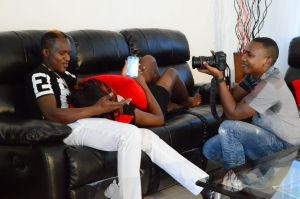Dr Eddie (squatting) filming a scene during the making of 'Nitangoja' video by Eldoret-based musician Sweet Boy.